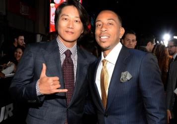 <em>Furious 7</em> has hit the $1 billion worldwide box-office mark, two days faster any other film. Earlier this month, stars Sung Kang, left, and Ludacris attend the film's Los Angeles premiere.