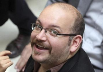 Jason Rezaian, an Iranian-American correspondent for the <em>Washington Post, </em>faces four serious charges, including espionage, according to his lawyer. He's shown in 2013.