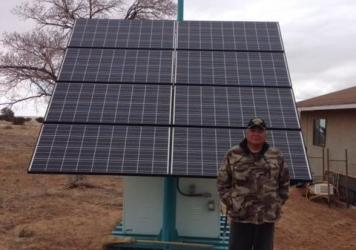 This solar panel unit cost about $17,000, less than half as much as it costs to extend the electrical grid a mile. Homeowner Leo Thompson pays the power company $75 a month to maintain and service the unit.