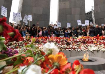 Armenians lay flowers Tuesday at the Tsitsernakaberd Armenian Genocide Memorial in Yerevan, Armenia. Armenians on Friday will commemorate 100 years since 1.5 million of their kin were killed by Ottoman forces. Armenians and many historians call it the first genocide of the 20th century, but Turkey fiercely rejects that label.