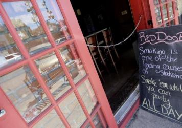A sign outside The Red Door lounge last weekend warned about the impending smoking ban in New Orleans.