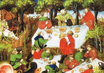 An illustration of noblemen enjoying a feast outdoors, from a French edition of <em>The Hunting Book of Gaston Phebus</em>, 15th century.
