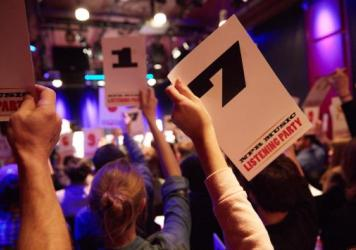 Guests hold up ratings cards at an <em>All Songs Considered</em> listening party in Boston.