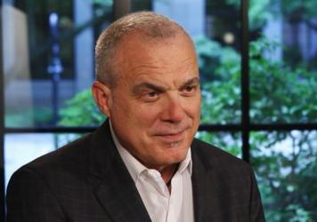 Aetna recently announced one of its largest pay hikes recently. CEO Mark Bertolini says he believes it largely could pay for itself by making workers more productive.