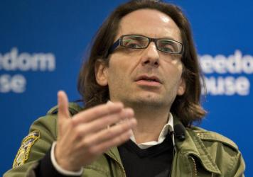 Jean-Baptiste Thoret, <em>Charlie Hebdo</em>'s film critic, speaks at a news conference in Washington on May 1. Thoret will receive, on behalf of <em>Charlie Hebdo</em>, the PEN American Center's Freedom of Expression Courage Award in New York on Tuesday