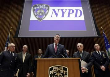 New York Mayor Bill de Blasio (center), City Police Commissioner William Bratton (second from right) and other NYPD officers address a news conference on Jan. 5. There is debate surrounding the citywide increase of low-level crime enforcement, otherwise