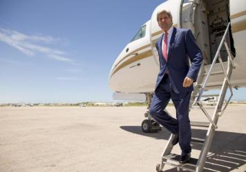 Secretary of State John Kerry arrives at the airport in Mogadishu, Somalia, on Tuesday. Kerry made the unannounced trip to Somalia in a show of solidarity with the government trying to defeat al-Qaida-allied militants.