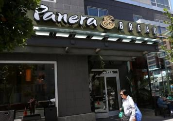 A pedestrian walks by a Panera Bread restaurant on June 3 in San Francisco. Panera Bread is set to remove artificial colors, flavors, sweeteners and preservatives from items on its menu by the end of 2016.