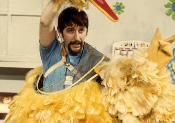 An archival photo of Caroll Spinney at work.