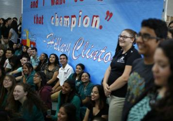 "Democratic presidential candidate and former U.S. Secretary of State Hillary Clinton speaks with student Betsaida Frausto on May 5 at Rancho High School in Las Vegas. Clinton said that any immigration reform would need to include a path to ""full and equa"