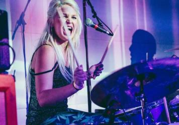 Purple's Hanna Brewer laying down the party-rock beats.