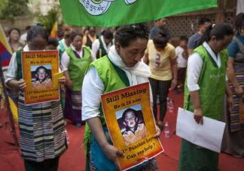 Members of Exile Tibetan Women Association protest to demand the immediate release of Gedhun Choekyi Nyima, the 11th Panchen Lama, during a gathering to mark the 20th anniversary of his disappearance, in New Delhi, India, on Sunday.