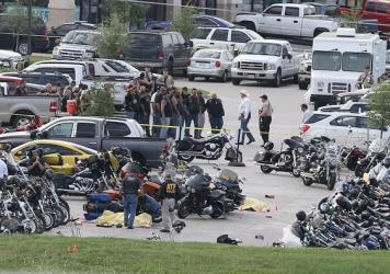 Authorities investigate a shooting in the parking lot of the Twin Peaks restaurant on Sunday in Waco, Texas.