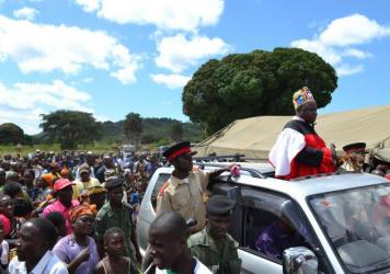 Village chiefs, residents and government officials take to the streets to celebrate the Chienge district's accomplishment of bringing sanitation to every home.