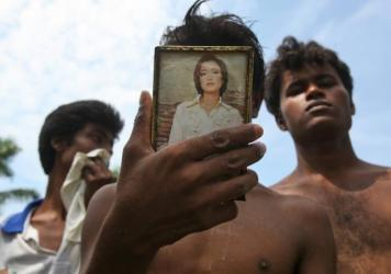 A newly arrived Rohingya migrant uses a mirror after taking shower at a temporary shelter in Bayeun, Aceh province, Indonesia, on Thursday.