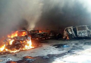 Vehicles burn, that authorities say caught fire during a gunbattle, in a warehouse at Rancho del Sol, near Ecuanduero, in western Mexico, on Friday. At least 43 people died Friday in what authorities described as a fierce, three-hour gunbattle between federal forces and suspected drug gang gunmen.
