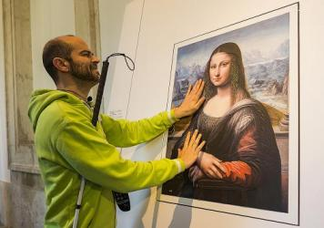 A blind visitor to Spain's Prado Museum runs his fingers across a 3-D copy of the Mona Lisa, painted by an apprentice to Leonardo da Vinci. The 'Touching the Prado' exhibit features 3-D versions of the museum's most famous works.