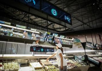 "Carlo Ratti of MIT designed this ""supermarket of the future"" exhibit. If you move a hand close to a product, a digital display lights up, providing information on origin, nutritional value and carbon footprint."