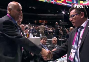 Palestinian Jibril Rajoub (left) and Israeli Ofer Eini shook hands Friday after FIFA's member groups adopted a plan to work out problems between their soccer associations.