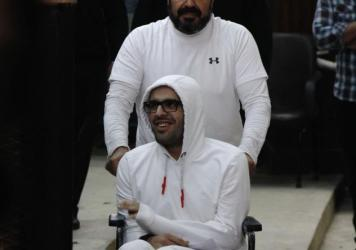A photo from March shows Mohammed Soltan being pushed by his father Salah during a court appearance in Cairo, Egypt. Soltan, a dual U.S.-Egyptian citizen, was ordered deported to the U.S. after a prolonged hunger strike protesting his prison conditions.
