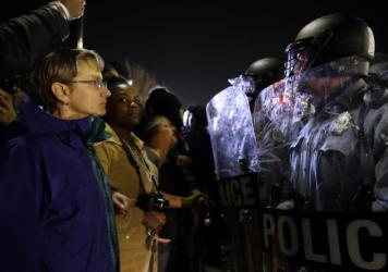 Police and protesters square off outside the Ferguson Police Department, in March.Earlier in the day, the resignation of Ferguson police chief Thomas Jackson was announced in the wake of a scathing Justice Department report prompted by the fatal shooting of an unarmed black 18-year-old by a white police officer.