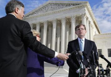 Attorney John Elwood talks to reporters Dec. 1 outside the Supreme Court building in Washington after arguing on behalf of Anthony Elonis, who was convicted in 2010 on the grounds of threatening his wife via social media. On Monday the court ruled in favor of Elonis, saying prosecutors must prove that a social media threat was intentional, not just perceived.