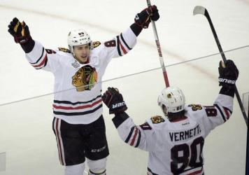 Chicago Blackhawks center Antoine Vermette (80) of Canada, celebrates his game winning goal with Teuvo Teravainen of Finland (86), against the Tampa Bay Lightning during the third period in Game 1 of the NHL hockey Stanley Cup Final in Tampa, Fla., Wedne