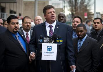 NYPD veteran Brian Fusco speaks to press outside the 72nd Precinct in the Brooklyn borough on Jan. 20. Fusco is running for president of the state's Patrolman's Benevolent Association in the upcoming election, against incumbent Patrick Lynch, who has bee