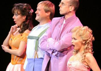From a 2012 New York Philharmonic production of <em>Candide, </em>Marin Alsop conducts a cast that includes (from right) Kristin Chenoweth, Jeff Blumenkrantz, Paul Groves and Janine LaManna.