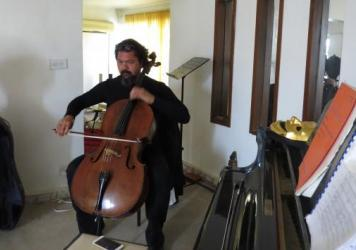 Karim Wasfi, conductor of the Iraqi National Symphony Orchestra, at his home in Baghdad, has been playing his cello at the sites of explosive attacks in Baghdad.