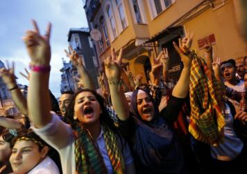 Supporters celebrate early election results outside the pro-Kurdish Peoples' Democratic Party (HDP) headquarters in Istanbul. The ruling Justice and Development Party, or AKP, has lost its majority according to preliminary results.