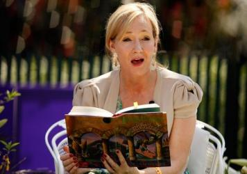 J.K. Rowling reads aloud during the Easter Egg Roll at the White House in 2010. We will neither confirm nor disconfirm the possibility that she was location-scouting for the American school.