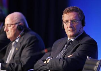 "FIFA Secretary-General Jérôme Valcke (right) and FIFA President Joseph ""Sepp"" Blatter attend a news conference in 2014."