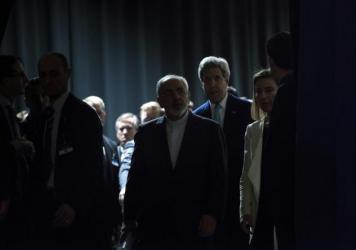 Iranian Foreign Minister Javad Zarif (center) with U.S. Secretary of State John Kerry in Lausanne, Switzerland, after talks over Iran's nuclear program wrapped up in April.