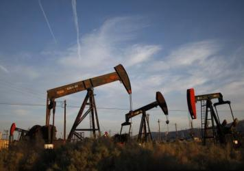 "Pump jacks and wells work in an oil field on the Monterey Shale formation in California. Economist Michael Porter says that hydraulic fracturing, or fracking, is a ""game changer"" for the U.S. economy."