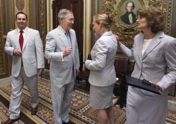 "Members of the Senate on ""Seersucker Thursday"" in June 2011. Sens. Mike Lee (left), Mitch McConnell, Kirsten Gillibrand and Lisa Murkowski."