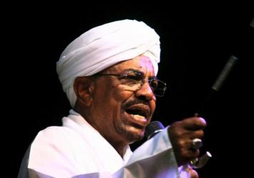 Sudan's President Omar Hassan al-Bashir speaks to the crowd after a swearing-in ceremony at green square in Khartoum, earlier this month. A South African court has ordered al-Bashir, who is attending an African Union summit in Johannesburg, to be detaine
