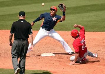 Did the St. Louis Cardinals try to steal more than second base from the Houston Astros? The FBI is looking into a hacking attack on a key Astros database. Here, the Cardinals' Aledmys Diaz is tagged out at second by Carlos Correa of the Astros during a spring training game in March.
