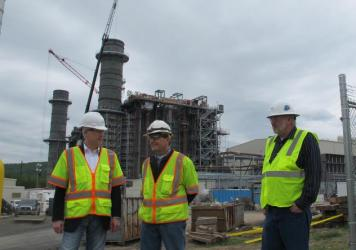 Bill Pentak of Panda Power Funds (left), Plant Manager John Martin (center) and Construction Manager Rob Risher (right) stand in front of the construction site for the new Panda Liberty gas power plant in Towanda, Penn. The plant, expected to come online