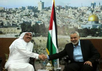 Qatar official Mohammed al-Emadi (left), visits Hamas leader Ismail Haniyeh in Gaza City on March 12. Israel has accused Qatar of financing Hamas weaponry, but still allows Qatar to spends millions in Gaza on aid and development projects.