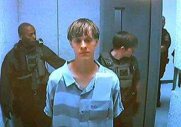 Dylann Roof appears via video before a judge in North Charleston, S.C, today. The 21-year-old man accused of killing nine people inside a black church in Charleston made his first court appearance and bail was set for $1 million on a charge of weapons po