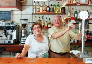 Pedro Barros Diéguez and Albina Macia Fernández, the husband-and-wife owners of Casa Pages, a traditional bar in Barcelona. Many of the city's historic, family-run businesses are in danger of closing because of rising rents, spurred by a huge spike in tourism