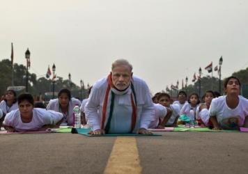 Prime Minister Narendra Modi performs yoga along with thousands of Indians on Rajpath, the mall of central New Delhi, for International Yoga Day.