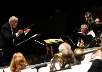 Gunther Schuller, shown conducting Charles Mingus's <em>Epitaph</em> in 2007, was a Pulitzer Prize-winning composer, conductor and educator. He died Sunday at age 89.