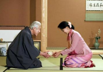 Myanmar democracy activist Aung San Suu Kyi (right) receives a bowl of green tea from Japanese tea master Genshitsu Sen at a tea ceremony in Kyoto during a 2013 visit to Japan.