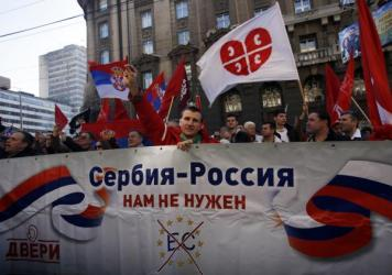 "Serbian protesters hold a banner that reads: ""Serbia-Russia, we don't need the European Commission"" on March 21 in Belgrade. The marchers were from a Serbian nationalist organization opposed to the government, which has pursued closer ties with Western Europe."
