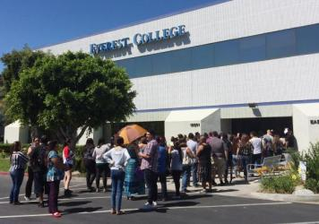 Students wait outside Everest College in Industry, Calif., hoping to get their transcriptions and information on loan forgiveness and transferring credits to other schools. In April, the school was one of the last Corinthian Colleges campuses to close.
