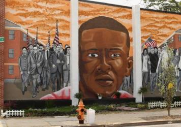 A mural memorializing Baltimore resident Freddie Gray adorns a wall near the place where he was tackled and arrested by police. <em>The Baltimore Sun</em> says it has acquired a copy of the unreleased government autopsy report in the case.