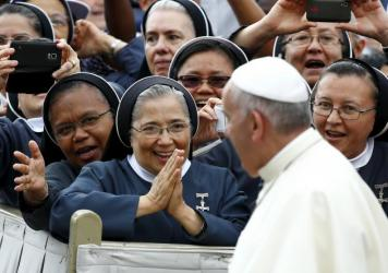 "Nuns greet Pope Francis as he arrives to lead the weekly audience in Saint Peter's Square at the Vatican on Thursday. The pope, speaking at his weekly general audience, said sometimes separation is ""morally necessary."""