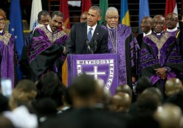 "President Obama sings ""Amazing Grace"" while delivering the eulogy for the Rev. Clementa Pinckney on Friday."